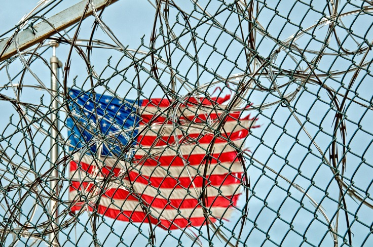 prison-370112_1920-flag-razorwire-pixabay-cc0-pubdom.jpg